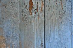 Hölzerne blaue Oberfläche mit Sprüngen und Verschleiß Stockbilder