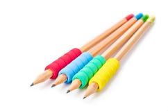 Hölzerne Bleistifte mit bunten Gummischaumgriffen Lizenzfreie Stockbilder