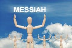 Hölzerne blinde Marionette auf Himmelhintergrund mit Wort MESSIAH Stockfotografie