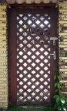 Hölzerne braune Tür Stockfotos
