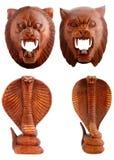 Hölzerne Figürchen, dekorative Figürchen, Tiger, Kobra, Schlange stockbild