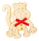 Hölzerne Form in Form eines Affen mit Dekorum eines Rotschmetterlinges Stockfoto