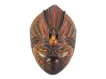 Hölzerne gemalte Maske auf Weiß Stockbild
