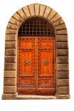 Hölzerne geschlossene braune Tür. Lizenzfreies Stockfoto