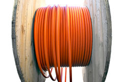 Kabeltrommel mit orange Kabel Stockbilder