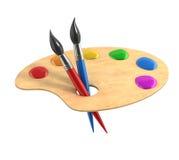 Hölzerne Kunstpalette mit Farben und Bürsten Stockfoto