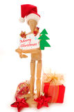 Hölzerne Mannequinholding-Weihnachtskarte Stockbilder