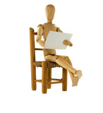Hölzerne Marionette, die einen Begriff liest lizenzfreies stockfoto