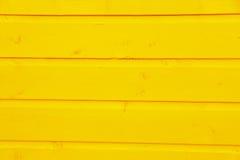 Hölzerne Planken des Holzes gelb gemalt Stockbild