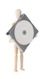 Hölzerne Puppe mit CD oder DVD lizenzfreies stockfoto