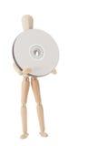 Hölzerne Puppe mit CD oder DVD lizenzfreie stockbilder