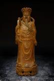 Hölzerne schnitzende Statue des Wohlstands-Geld-Gottes Stockbild