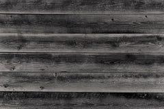 Hölzerne Schwarzweiss-Planken als Hintergrund Stockfotografie