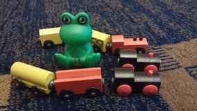 Hölzerne Spielwaren und Godzilla Stockfotos