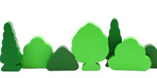 Hölzerne Spielzeugbäume getrennt auf Weiß Lizenzfreies Stockbild