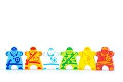 Hölzerne Spielzeugkarriere verschieden in der Uniform Lizenzfreies Stockfoto