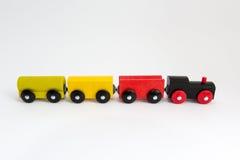 Hölzerne Spielzeugserie auf weißem Hintergrund Stockfotos