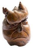 Hölzerne Statuette mit Gesicht des Dämons Stockfotografie