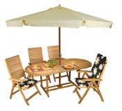Hölzerne Tabelle und Stühle Stockfotos