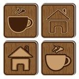 Hölzerne Tasten mit Ikonen eines kleinen Hauses und des a Lizenzfreie Stockfotografie