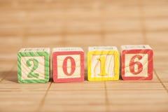2016 hölzerne Würfel des neuen Jahres Stockfotos