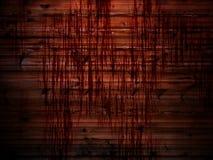 Hölzerne Wand mit Streifen des Bluts Stockfotos