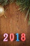 Hölzerner Feiertagshintergrund von guten Rutsch ins Neue Jahr 2018 Lizenzfreies Stockbild