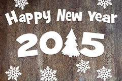 Hölzerner Hintergrund des guten Rutsch ins Neue Jahr - 2015 Stockbild