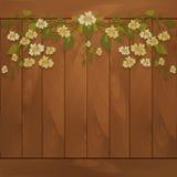 Hölzerner Hintergrund mit Blumen stock abbildung