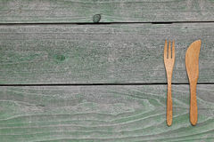 Hölzerner Löffel und Gabel, Messer Stockbild