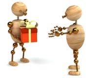 Hölzerner Mann mit Geschenkkasten Stockbild