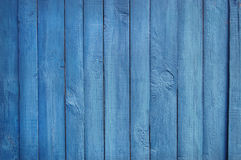 Hölzerner Palisadehintergrund, blaue Farbe Lizenzfreie Stockfotos