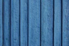 Hölzerner Palisadehintergrund, blaue Farbe Lizenzfreies Stockfoto