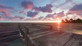 Hölzerner Pier auf dem Strand bei Sonnenuntergang Stockfotografie