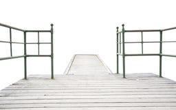 Hölzerner Pier mit Eisengeländer Stockbild