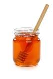 Hölzerner Schöpflöffel mit Glas Honig. Stockfotos