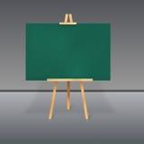 Hölzerner Stativ mit einer grünen Tafel Stockbilder