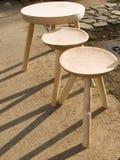 Hölzerner Stuhl drei mit drei Fahrwerkbeinen Stockbild
