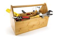 Hölzerner Werkzeugkasten mit Hilfsmitteln Lizenzfreie Stockfotografie