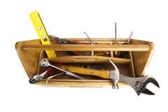 Hölzerner Werkzeugkasten mit Hilfsmitteln Stockbild