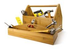 Hölzerner Werkzeugkasten mit Hilfsmitteln Lizenzfreies Stockbild