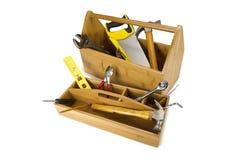 Hölzerner Werkzeugkasten mit Hilfsmitteln Lizenzfreie Stockbilder