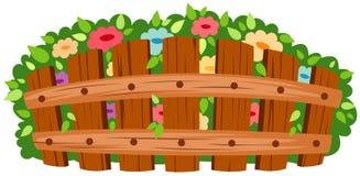 Hölzerner Zaun mit Blumen stock abbildung