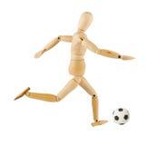 Hölzernes Baumuster mit einer Fußballkugel Lizenzfreies Stockbild