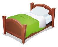 Hölzernes Bett mit grüner Decke