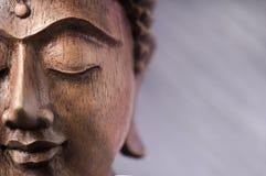 Hölzernes Buddha-Gesicht Stockfotos
