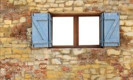 Hölzernes Fenster auf Backsteinmauer Stockfotografie