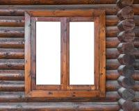 Hölzernes Fenster in einer Klotzwand Stockfotos