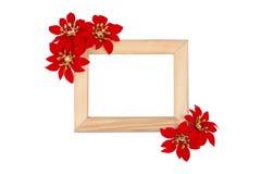 Hölzernes Fotofeld mit roten Blumen Stockfoto