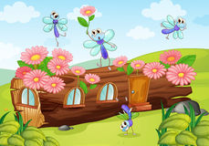 Hölzernes Haus und Fliegen stock abbildung